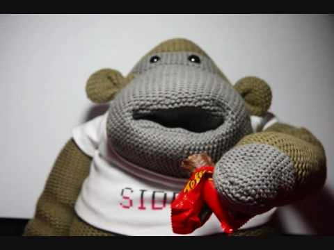 sock monkey eating candy