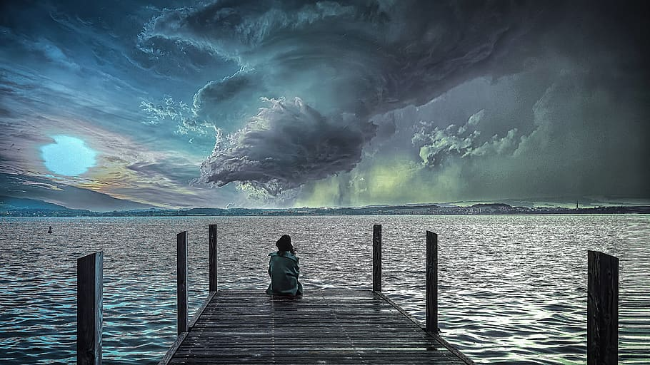 storm clouds and person