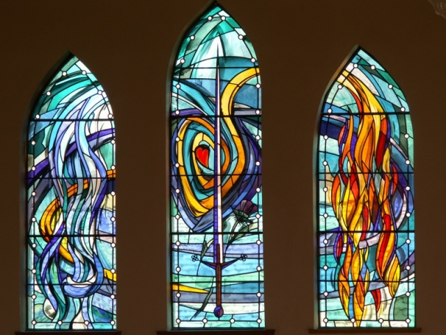 Church stained glass windows sword dividing